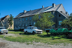 Old soviet cars near house in german style Royalty Free Stock Image