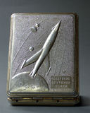 Old soviet  cigarette box. Old soviet metal cigarette box produced in 60-ies and decorated with soviet Sputnik orbiting Earth Royalty Free Stock Photos