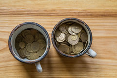 Old soviet coins in a rusty enamel cup Stock Photo