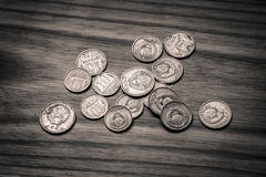 Old soviet coins on a wooden background - monochrome vintage loo Royalty Free Stock Photo