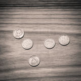 Old soviet coins on a wooden background - monochrome vintage loo Royalty Free Stock Images