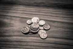 Old soviet coins on a wooden background - monochrome vintage loo Royalty Free Stock Photos