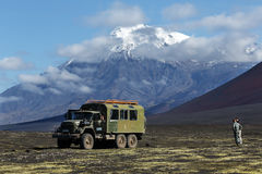 Old soviet extreme expedition truck on volcanic slag field on ba. TOLBACHIK VOLCANO, KAMCHATKA PENINSULA, RUSSIA - AUGUST 27, 2014: Old soviet extreme expedition Royalty Free Stock Photo