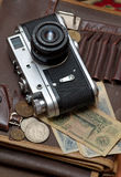 Old soviet film camera and money. Vertical close up Royalty Free Stock Photos