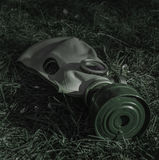 The old Soviet gas mask on the grass in gloom of night. The old Soviet gas mask on the grass in the gloom of night stock images