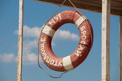 Old soviet lifebuoy at sea Royalty Free Stock Images