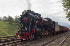 Old Soviet locomotive at the station Royalty Free Stock Photos