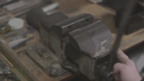 Old soviet mechanics bench vices are being contracted and expanded stock video footage