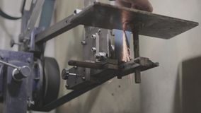 Old soviet mechanics bench vices are pressing the bottle cap stock footage
