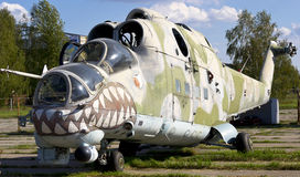 Old Soviet military helicopter MI-24. With bullet prints on glass from Afganistan Stock Photo
