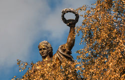 The old Soviet mosaic sculpture of a woman with a wreath Stock Image