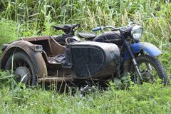 Old Soviet motorcycle with a cradle. An old mototechnique.  stock photography