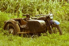 Old Soviet motorcycle with a cradle. An old mototechnique.  stock image