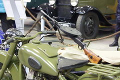 Old soviet motorcycle with machine-gun close-up Stock Images