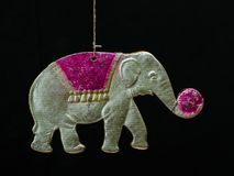 Old soviet paper christmas decoration. Circus elephant with ball Stock Photo