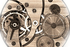 Old soviet pocket watch mechanism in sepia Stock Photography