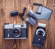 Old soviet rangefinder camera,exposure meter and another trappings of film photography. Old soviet rangefinder camera,exposure meter and another trappings of Stock Photos
