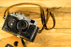 Old soviet rangefinder camera on a wooden table Royalty Free Stock Photo