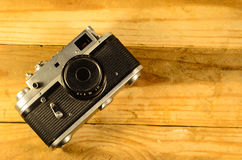 Old soviet rangefinder camera on a wooden table Stock Photography