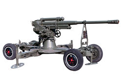 Old soviet or red army anti-aircraft cannon. Old time vintage soviet or red army museum exhibit anti-aircraft gun or Russian flak on wheels over white Stock Images
