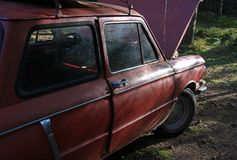 An old Soviet red car. An old Soviet red retro car in the woods Royalty Free Stock Photography