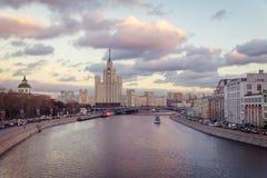 Old soviet skyscraper on Kotelnicheskaya embankment and Moskva river evening view stock photos