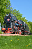 Old Soviet steam locomotive on the background of nature. Vertical Stock Images