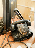 Old Soviet telephone, next to the computer Stock Photo