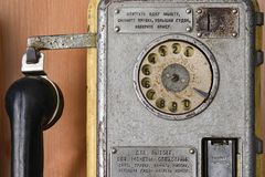 Old Soviet telephone payphone with a disk dialer, call special services, retro, close up. Old Soviet telephone payphone with disk dialer, call special services stock photo