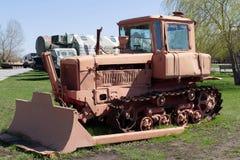 Old  Soviet tractor caterpillar. Stock Photos