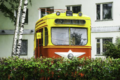 Old Soviet tram mid-20th set as a monument. To the Soviet public urban transport Stock Photos