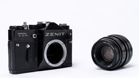 Old Soviet Zenit TLL 35 mm film camera isolated on white with He. Witch Helios 44-2 lens Royalty Free Stock Photography