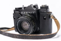 Old Soviet Zenit TLL 35 mm film camera isolated on white with He. Witch Helios 44-2 lens Stock Photo
