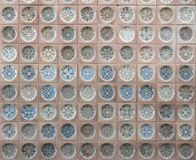 Old Spanish ceramic tiles with patterns, facing on the building stock images