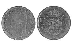 Old Spanish coin of 5 pesetas.1975. On white background royalty free stock photo