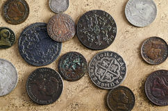 Old Spanish Coins. Collection of old Spanish coins on a background old textured background Royalty Free Stock Photo