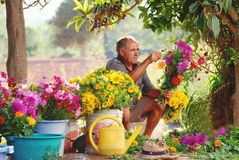 Old Spanish farmer making country flower arrangements