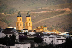 Old Spanish mountain village. Órgiva is a municipality in the Alpujarra mountains in Spain. Seen from south side by sunset Royalty Free Stock Photos