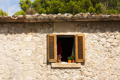 Old Spanish style window. Spanish window with open sheets royalty free stock photo