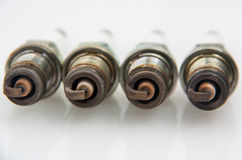 Old spark plugs on a white background. Royalty Free Stock Photography