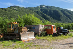 Old special machines in brookvalley Spokoyny at foot of outer north-eastern slope of caldera volcano Gorely. Stock Photos