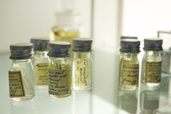 Old specimen bottles on a glass shelf. Royalty Free Stock Images