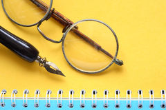 Old Spectacles On Notebook Royalty Free Stock Image