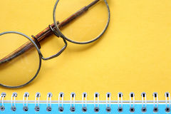 Old Spectacles On Notebook Stock Photos