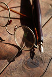 Old Spectacles And Pen Stock Image