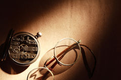 Old Spectacles And Watch Royalty Free Stock Image