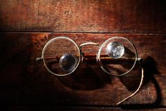 Old Spectacles On Wood Royalty Free Stock Photos