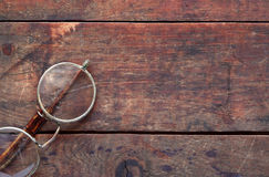 Old Spectacles On Wood Stock Photo