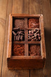 Old spicy box full of chocolate Stock Photos
