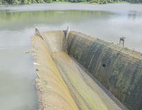 Old spillway on concrete small dam Royalty Free Stock Image